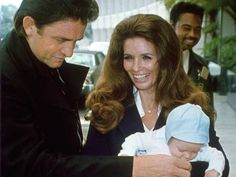 Johnny Cash and June Carter Cash with baby John in 1970