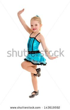 Cute Little Girl Tap Dancer Poses with Leg  Lifted in Tap Shoes and Costume by Lorraine Swanson, via Shutterstock