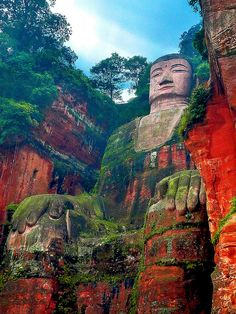 The Leshan Giant Buddha  was built during the Tang Dynasty (618–907AD). It is carved out of a cliff face that lies at the confluence of the Minjiang, Dadu and Qingyi rivers in the southern part of Sichuan province in China, near the city of Leshan. The stone sculpture faces Mount Emei, with the rivers flowing below his feet. It is the largest carved stone Buddha in the world and it is by far the tallest pre-modern statue in the world.