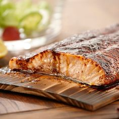 Make a simple and flavorful rub for salmon using just brown sugar and chili powder. Grilling on a cedar plank will give the salmon a light, smoky flavor and make clean up a breeze.