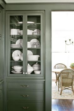 Every Southern kitchen needs a spot to display china. Our glass-front cabinets flank the opening to the dining room for easy access.