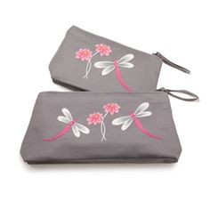 @WorldCrafts {Miao Cosmetic Bag Set ~ China Ethnic Crafts ~ China} Hand-embroidered dragonflies and flowers embellish this durable cosmetic bag set. Each bag is helping the Miao women of China continue their tradition of fine embroidery and provide an income for their families while working at home. Set includes 2 bags that are lined with black plastic and have a zippered closure. Small: 8.25-by-2-by-4.25 inches Large: 11.5-by-2-by-5 inches. #fairtrade