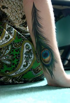 55 Peacock Feather Forearm Tattoo