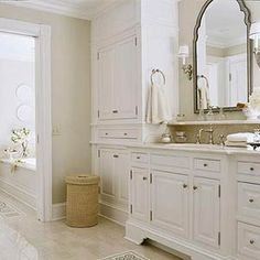 light beige floor tile and walls with white cabinets