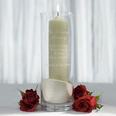 Create a memorial for lost loved ones with this multi-purpose glass cylinder. Light a candle within in their honor or fill it with their favorite flowers. To make the memorial as personal as possible, have it engraved with names or a message. Available for purchase online at http://madelinesweddings.weddingstar.com/product/memorial-glass-cylinder