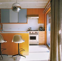 Mirror Ball pendant by Tom Dixon on kitchen ceiling