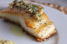 Chilean Sea Bass with Fresh Herbs & Sautéed Garlic - Chelsea Arnold-Fuller Fish Dishes, Seafood Dishes, Fish And Seafood, Seafood Recipes, Cooking Recipes, Healthy Recipes, Shellfish Recipes, Salmon Recipes, Healthy Eats