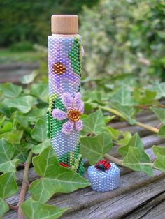 seed beaded needlecase with 3d flowers and ladybirds