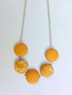 Items similar to Covered button necklace in Mustard on Etsy Jewelry Crafts, Jewelry Art, Beaded Jewelry, Handmade Jewelry, Jewelry Design, Jewlery, Button Necklace, Diy Necklace, Button Jewellery