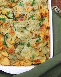 A delicious, soy-free vegan zucchini breakfast strata with mashed potatoes and basil lemon cream. Perfect to eat any time of the day.