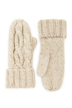 A pair of midweight cable knit mittens featuring a thumb insert and a ribbed trim.