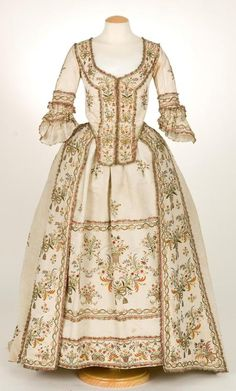 Front view Sacque gown a la Piedmontese, ca. 1780, Italy (?), plain cream ribbed silk, metallic and silk embroidery. Metallic lace borders all the embroidery elements.