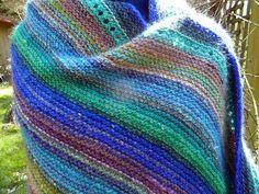 "A simple garter Prairie Shawl from Cheryl Oberle's book ""Folk Shawls"". Made using scraps of Noro Silk Garden Yarn"