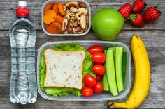 Healthy lunch boxes with sandwich and fresh vegetables, bottle of water, nuts and fruits on rustic wooden background. Healthy Snacks For Diabetics, Super Healthy Recipes, Healthy Foods To Eat, Lunch Recipes, Healthy Dinner Recipes, Lunch Meals, Eat Lunch, Eating Healthy, Crockpot Recipes