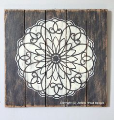 """Distressed, Handmade Floral Mandala Wood Painting (Gray and White)- Fits Shabby Chic, Rustic, Reclaimed Wood, Pallet, Industrial, Boho, Zen or Urban Wall Decor. Measures 15"""" by 14"""". This 15 by 14 inch piece features a beautiful floral mandala that almost seems three dimensional. The distressed gray background will match any decor and the hand painted white mandala provides a feeling of peace and serenity. My canvasses are all hand made from floor boards that I distress. All pieces are…"""