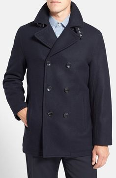 """Michael Kors Wool Blend Double Breasted PeacoatA broad collar and crisp tailoring define a classic wool-blend peacoat modernized in a comfortable, masculine profile that goes easy on the details save for an adjustable belt at the collar. 32"""" length (size Medium). Front button closure. Lined. 60% wool, 30% polyester, 10% rayon; Brown Heather and Heather Grey are 60% wool, 30% polyester, 5% nylon, 5% other fibers; Loden Green is 63% wool, 32% polyester, 5% other fibers. Dry clean"""
