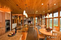 Barndominium Floor Plans for a Traditional Kitchen with a Floating Staircase and Saranac Lake House by