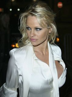 Pamela Anderson has protested against plans to put Colonel Sanders on a stamp. Description from majorwager.com. I searched for this on bing.com/images White Satin Blouse, Satin Shirt, Satin Blouses, Silk Satin, White Blouses, Sexy Blouse, Blouse Dress, Famous Blondes, The Most Beautiful Girl