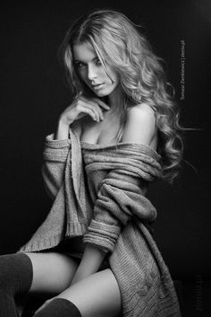 black and white beauty shot, oversized sweater off the shoulder with dark stockings