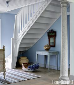 The Scandinavian staircase was totally rebuilt in a style adapted from other cottages in the area, with cutout railings — the typical country interpretation of more elaborate carved and turned balusters.