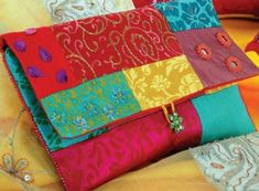 The perfect pieced clutch bag. Pretty in cottons but stunning in your scraps of special fabrics such as silks and satin. Add embroidery and embellishments, beads etc for a truly gorgeous piece. Free pattern.