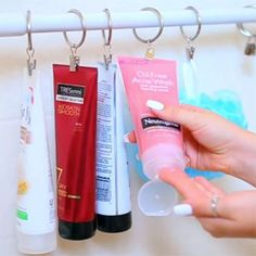 ShowerStorage-- This is such a clever idea. Using a shower curtain rod and clips you can keep your bath products off your bathtub corners and have even easier access without needing to bend over.