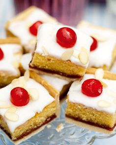 Iced bakewell tart tray bake Take the classic bakewell tart recipe and make it into a tray bake in this recipe. A golden layer of shortcrust pastry topped with an almond cake, strawberry jam, icing and glacé cherries. Tray Bake Recipes, Tart Recipes, Sweet Recipes, Dessert Recipes, Baking Recipes Uk, Iftar, British Baking, Profiteroles, Shortcrust Pastry