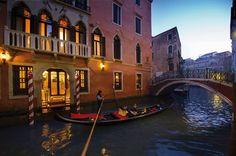 Venice, Italy | A wonderfully restored 17th-century Venetian palazzo, Hotel Ai Reali enjoys an idyllic location by a quiet, narrow canal near Rialto Bridge.