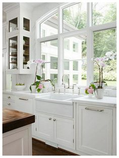 white kitchen and orchids   # Pin++ for Pinterest #