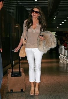 This one piece will wake up your cold-weather wardrobe in a jiffy: the white jean. Pair it with a black turtleneck or a fur coat like Liz Hurley has done.Wear white jeans with neutrals, brights or prints; with sweaters now and tees later.