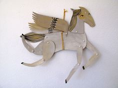 Articulated White Winged Horse by Emma Kidd on Etsy.