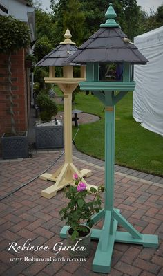A beautiful and bespoke wooden bird table, bird feeder hand crafted and hand painted in Lincolnshire, England by Robinson Garden. Visit our website for more details. Wood Bird Feeder, Bird Feeder Plans, Garden Bird Feeders, Bird House Feeder, Unique Bird Feeders, Garden Totems, Glass Garden, Homemade Bird Houses, Homemade Bird Feeders