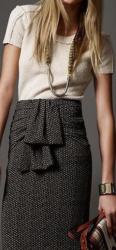 tweed pencil skirt, short sleeved knit top, chain necklace, oversized bracelet.