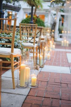 Illuminate your wedding ceremony by lining the aisle with an assortment of candles such as this ceremony captured at The Ritz-Carlton, New Orleans. Photo by Greer Gattuso