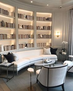 Beautiful library space. Home interior. Bookshelves. Lounge area. Living room inspiration.