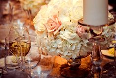 A centrepiece of cream and blush flowers