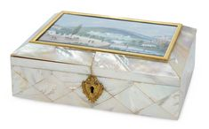 """7"""" (18 cm.) x 4 1/2"""". Having fine mother-of-pearl veneers with elaborate gilt escutcheon,and frame that surround a miniature watercolor featuring an elaborate background including the Weilburg palace with surrounding towers,countryside,mountains,rivers,bridge,village and a wide boulevard with 17 persons featured in various activities. The case opens to mirrored back with coral cording and with original velvet-fitted base containing an original set of mother-of-pearl sewing tools"""