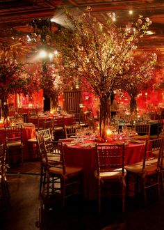 This looks like our wedding...but we used iron trees for the bases and attached over 150 curly willow and silk cherry blossom stems... It was so romantic