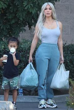 Kim Kardashian wearing Yeezy Calabasas Sweatpants and Adidas Yeezy Wave Runner 700 Sneakers