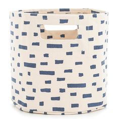 """Part of our exclusive collaboration with Pehr Designs, Finn coordinates with any of our indigo C3 bedding and bath accessories, including towels, bath mats, shower curtains, and window panels.   • 100% cotton.  • 10"""" x 9"""".  • Screen printed.  • Circular bin with 1 seam and built-in handles."""