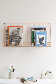 Keep your workspace clutter-free with this wire display shelf.