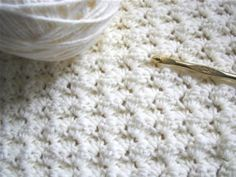 Easy blanket stitch. It is just sets of 3 stitches, one single crochet and two doubles. You can change colors after a few rows for a multicolored effect..