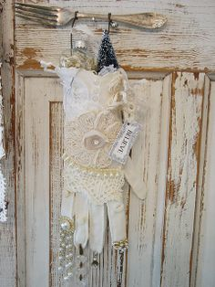 Lovely altered Christmas glove! Don't you just love it with the lace and the silver fork on the chippy white background?
