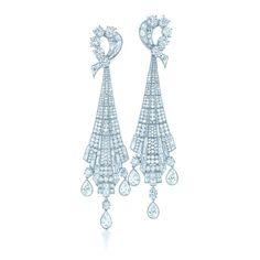 Diamonds share the sublime grace of New York City's Art Deco skyscrapers. Drop earrings of diamonds in platinum.