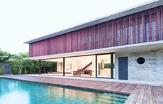 Swiss Thai House combines reclaimed materials with a gorgeous pool for a serene tropical abode