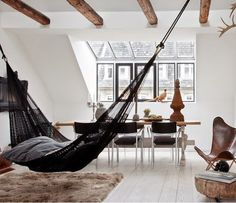 faux wood beams, black and white interior with hammock