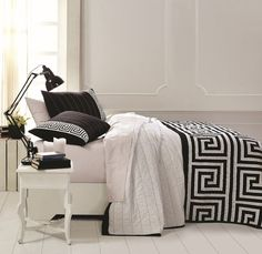 Looking for a bold, patterned, structured and strong feel in a quilt (similar to that of the Greek Goddess Athena)? The Athena pattern features a classic but on-trend Greek key design in high-contrast tones on a white background. Available in 3 bold colors. See this at The BitLoom: https://www.thebitloom.com/collections/bohemian-eclectic-bedding/products/athena-black-blue-green-greek-key-quilt-sets#content