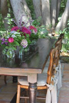 charming rustic table with pretty arrangements