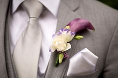 Purple calla lily boutonniere with gray suit and silver tie {Kyo Morishima Photography}