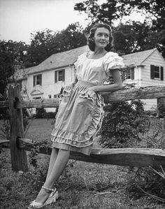 1944  The ruffles are absolutely everything in this look, while her wedges give it a modern feel.